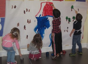 Painting a volcano mural for Dinosaur week